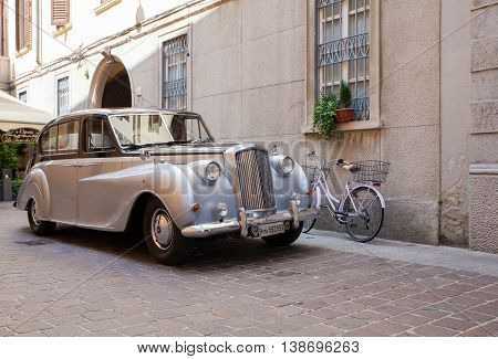 COMO, ITALY - JUNE, 12:  View of ancient Vanden Plas Princess limousine parked in the street on June 12, 2016