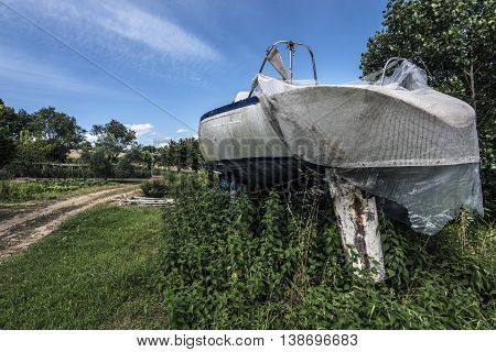 Small white boat in a garden countryside