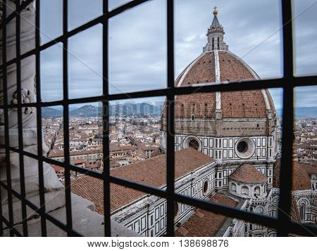 florence cathedral behind bars in urban landscape