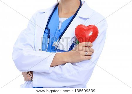 Positive female doctor standing with stethoscope and red heart symbol isolated