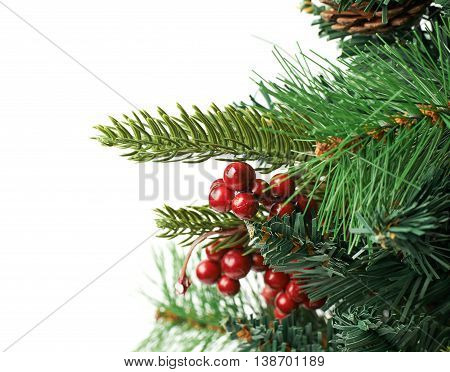 Close-up fragment of a Christmas tree isolated over the white background as a copyspace backdrop composition