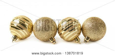 Multiple golden Christmas tree decorational balls arranged in a line, composition isolated over the white background