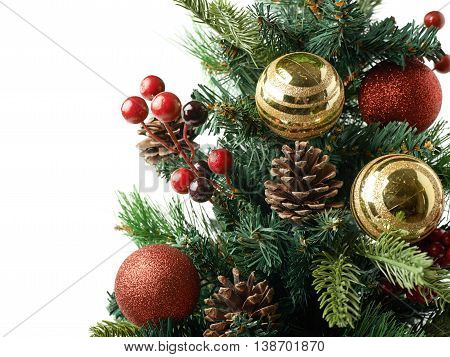 Close-up fragment of a Christmas tree decorated with balls, composition isolated over the white background as a copyspace backdrop