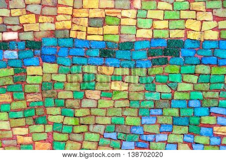 Wall made of colorful stone tiles background