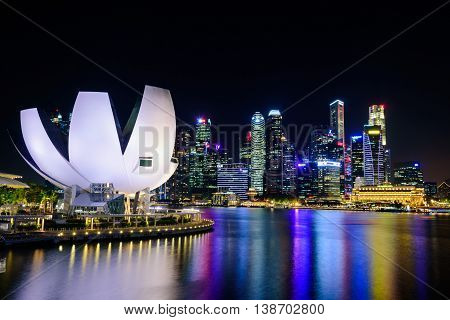 SINGAPORE-JULY 8 2016: Singapore city skyline and view of skyscrapers around Marina Bay at night on July 8 2016.