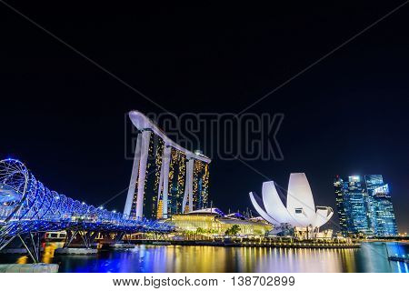 SINGAPORE - JULY 82016 : Helix Bridge and Marina Bay Sand Hotel at night time landmark in Singapore.