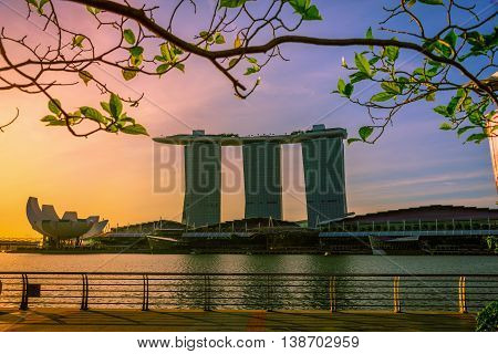 SINGAPORE - JUL 9, 2016: Cityscape of Singapore city skyline with Marina Bay Sands hotel and Art Science museum in Marina Bay at sunrise.