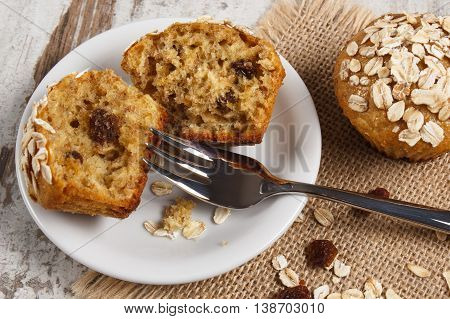 Fresh Muffins With Oatmeal Baked With Wholemeal Flour On White Plate, Delicious Healthy Dessert