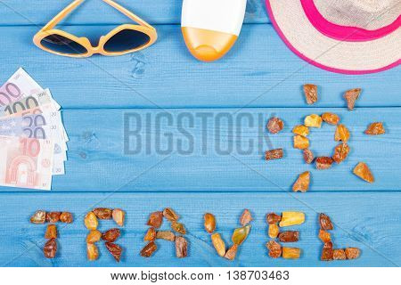 Word Travel With Shape Of Sun, Sunglasses, Sun Lotion, Straw Hat, Currencies Euro, Copy Space For Te