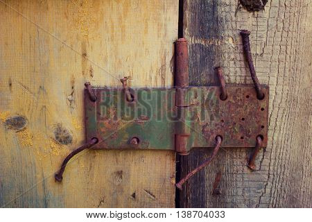 Grunge background with half painted wooden door and old canopy with rusty nails