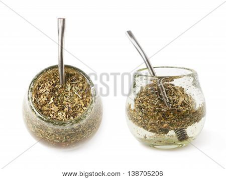 Glass mate calabash vessel filled with a mate tea and bombilla drinking straw inside it, composition isolated over the white background, set of two different foreshortenings