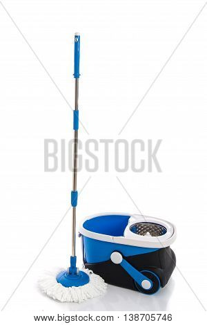 Blue mop and blue bucket isolated on white background