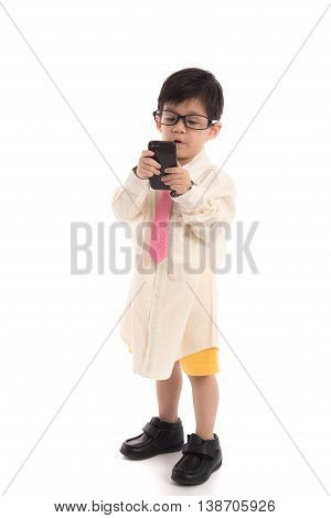 Little asian child pretending to be businessman using smart phone on white background isolated