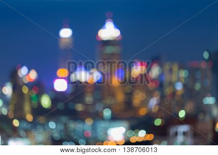 Abstract blurred lights city office building at twilight
