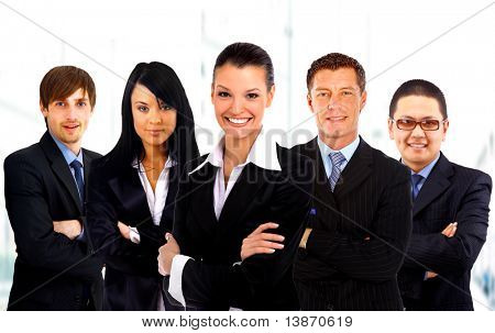 Leader and her team, Young attractive business people with focus only on businesswoman in the middle