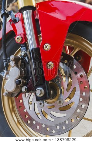 Close up of motorbike disk brake, Front view.