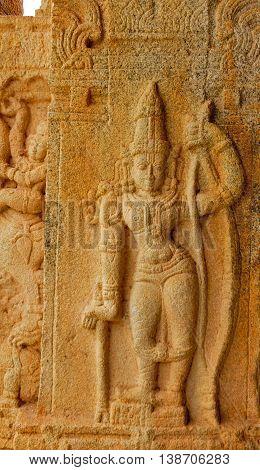 Sculptor of Lord Rama in standing posture on pillar of ancient Vishnu temple at Rangasthala, Chikkaballapura, Karnataka captured on July 16th, 2016