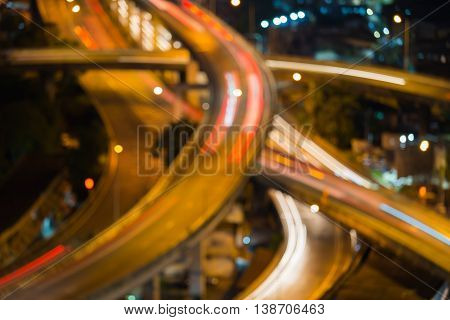 Blurred lights close up highway intersection, abstract background