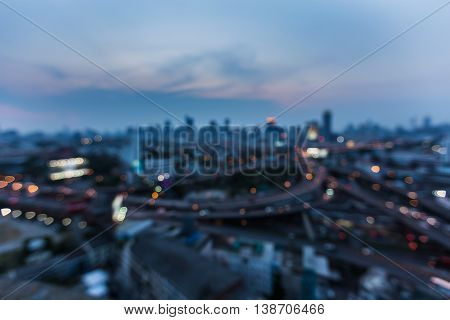 Night blurred light highway interchange and city downtown background