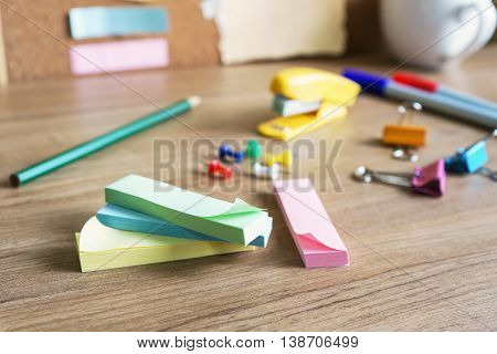 Sticky note and Office supplies on wooden table