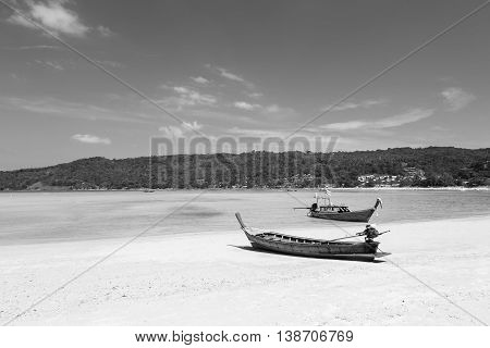 Black and White, Long tail Fishing boat on the beach, natural landscape background