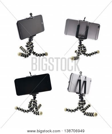 Smartphone set up on a tripod isolated over the white background, set of four different foreshortenings