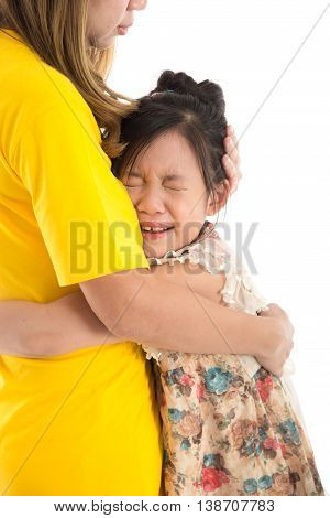 Asian Mother embracing and consoling daughter on white background iisolated