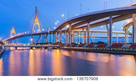 Bangkok Suspension bridge connect to highway riverfront at twilight, Thailand