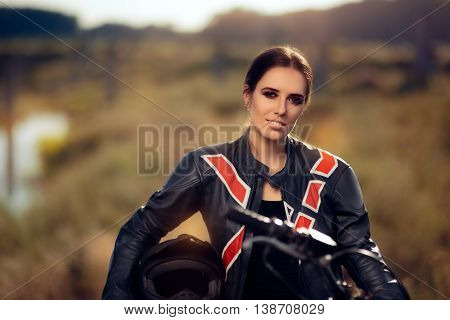 Female Motocross Racer Next to Her Motorcycle