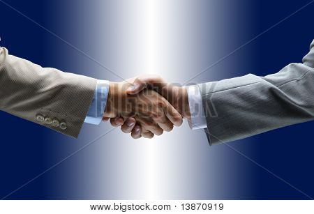 handshake isolated on blue background