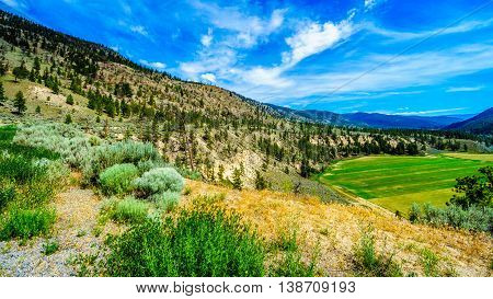 Fertile Farmland amidst the mountains along the Nicola River between Merritt and Spences Bridge in British Columbia, Canada