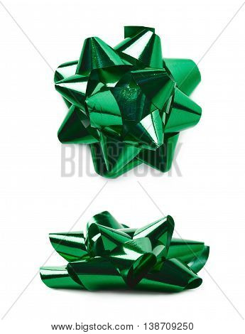 Decorational bow made of glossy green tape, composition isolated over the white background, set of two different foreshortenings