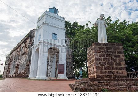 Statue of St. Francis Xavier in front of the ruins of St. Paul's Church in Malacca Malaysia.