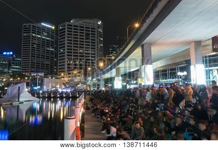 16 July 2016: Darling Harbour, Sydney AUSTRALIA: people waiting for the 8.30pm fireworks display at the Cool Yule Festival