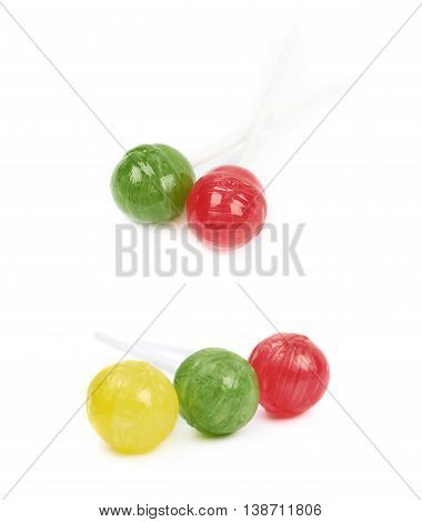 Multi-colored lollipop candies composition isolated over the white background, set of two different foreshortenings