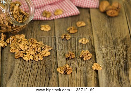 walnuts on rustic old wooden table. walnuts on rustic old wooden table.