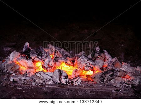 glowing red hot coals in a home oven