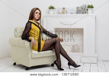 beautiful young girl shows beznes woman advertises clothing catalog business style in bright light studio