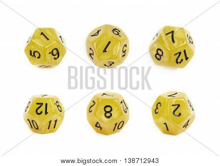 Yellow roleplaying polyhedral dodecahedron gaming plastic dice isolated over the white background, set of six different foreshortenings