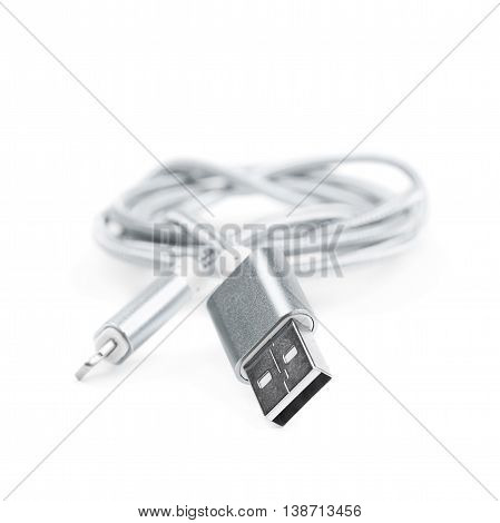 Folded USB lightning silver metal cable isolated over the white background
