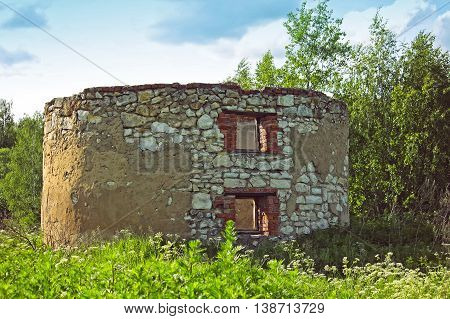 abandoned old round building in a forest