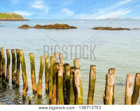 Breakwaters in high flow. Seashore Saint-Malo, Brittany, France