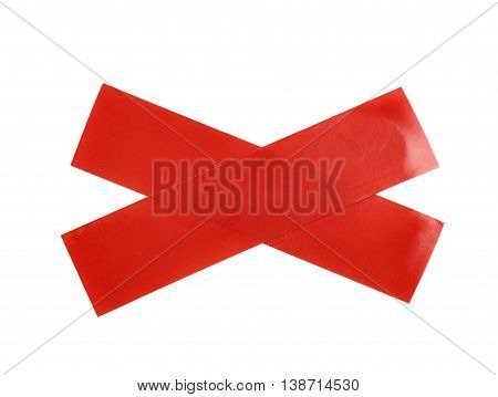 Cross made of two pieces of insulating tape isolated over the white background