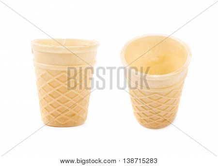 Wafer style empty waffle cone isolated over the white background, set of two different foreshortenings