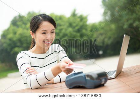 Woman paying credit card in pos terminal