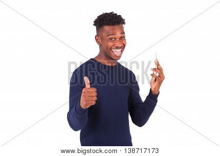 Young African American Man  Holding His Smartphone And Making A Thumbs Up Gesture - Black Teenager P
