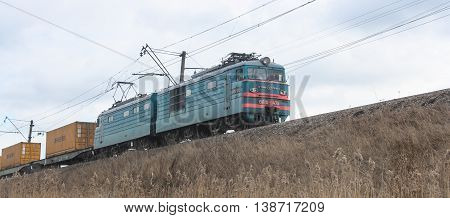 St. Petersburg, Russia - 7 April, Locomotive with wagons, 7 April, 2016. Transport on rail locomotives and wagons with tanks.