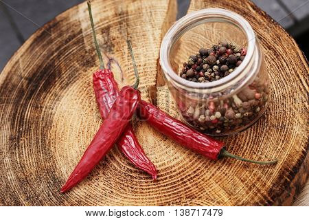 Chili pepper with peppercorn on the table