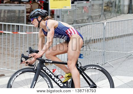 STOCKHOLM - JUL 02 2016: Side view of female triathlete cyclist Katie Zaferes (USA) in the Women's ITU World Triathlon series event July 02 2016 in Stockholm Sweden