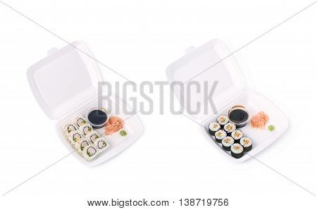 Set of sushi rolls served in a delivery container package, composition isolated over the white background, set of two different foreshortenings